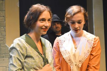 Actors Kadey Lynn Ballard and, who play the sisters Mauzy and Rainey, are pictured in the foreground during a recent rehearsal. Behind them, actor James Coble, who plays a traveling preacher, is pictured.