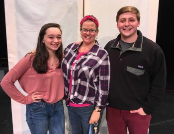 Rachel Sabo-Hedges, Sarah Miller and Collin Linville on stage at WHS with a piece of 'Mea Cupla's' set.