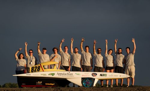 Appalachian State University's Team Sunergy celebrates their third place win at the Formula Sun Grand Prix at the Pittsburgh International Race Complex in Wampum, Pennsylvania. Pictured (left to right) are Abby Hastings, James Furr, Jon Linck, Bailey Winecoff, Jake Barnes, Logan Ward, Andrew Grimes, Pedro Franco, Lindsay Rudisill, Duvey Rudow and Dan Blakeley. Photo by Marie Freeman.
