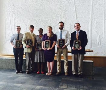 From left are award winners Miles Britton, Skip Rackmill, Kelly McBride, Kayla Hill, Andrew Hawley and Craig Caldwell. Not pictured, Beth Davison.