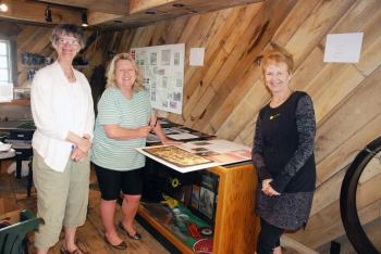 Vanessa Hammel, Tense Banks and Reesa Larsen are pictured working in the Avery County Historical Museum.