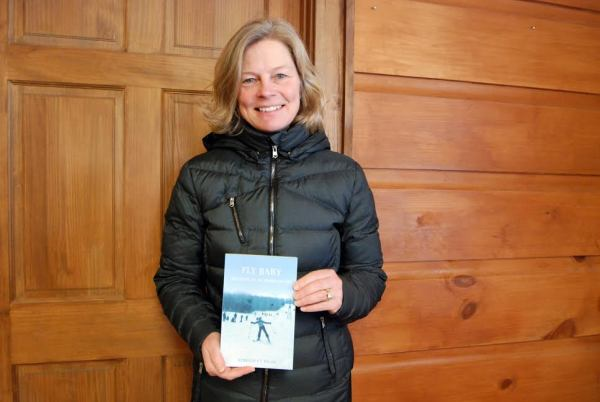 Kim Jochl poses with her latest book inside the offices of High Country Press. Photo by Ken Ketchie