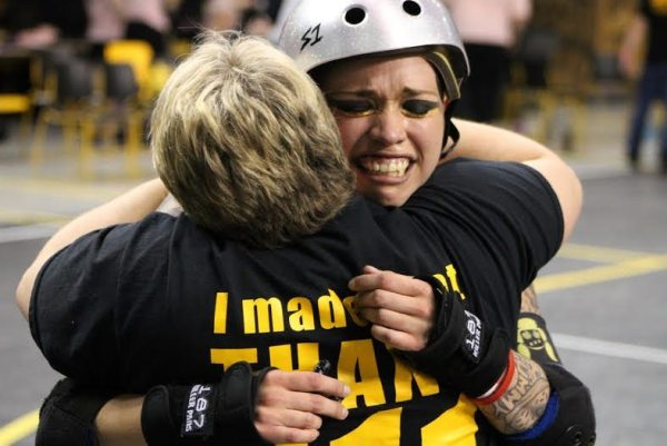 MVP Jammer, P.Y.T. embraces her mother after scoring 35 points in the last minute of the jam, winning the bout for ARG. Photo by Kevin Gordon.