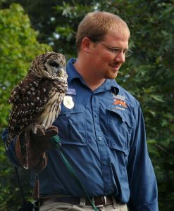Jesse Pope, director of education and natural resources, leads an educational program with Shakespeare, a barred owl, on Grandfather Mountain. Photo courtesy of Grandfather Mountain Stewardship Foundation.