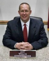 Democrat John Welch will remain a commissioner.