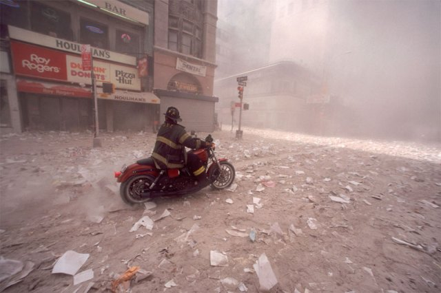 Firefighter Tim Duffy arrives downtown on his Harley after first tower collapse, 9/11/2001.