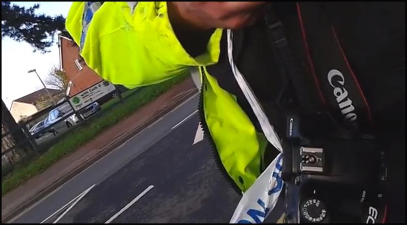 Policeman-takes-camera