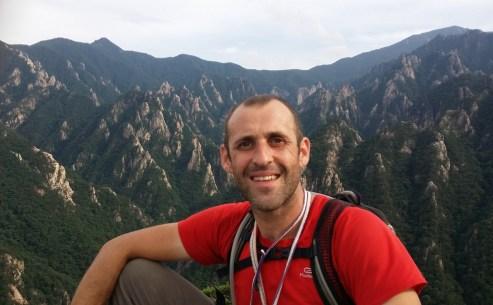Stephane Coupleux at the top of Janggun Bong Rock Climbing South Korea Seoraksan