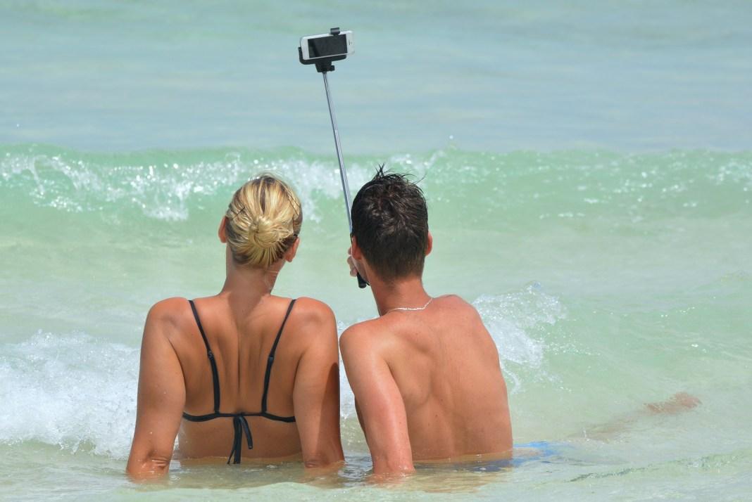 couple takes selfie beach