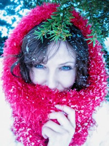Woman wearing a red scarf in the snow