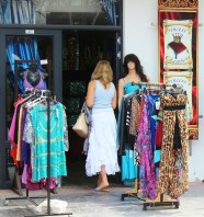 woman shopping in a colourful boutique