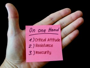 hand holding a post it note