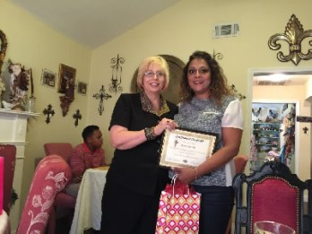 Arlene receiving certificate from graduation from the 2015 Touch of God Healing and Deliverance School of Ministry