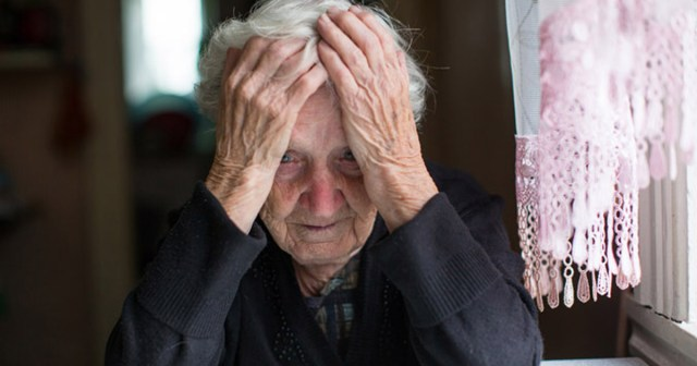 old woman with head in hands