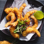 Coconut-crumbed prawns with lime aioli