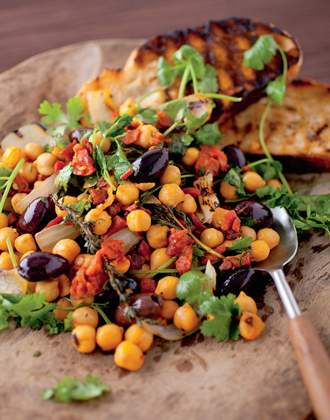 Chorizo and Chickpeas with Charred Onions, Black Olives, and Herbs Recipe