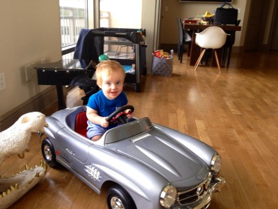 Playing in his new vintage Mercedes SLS car!