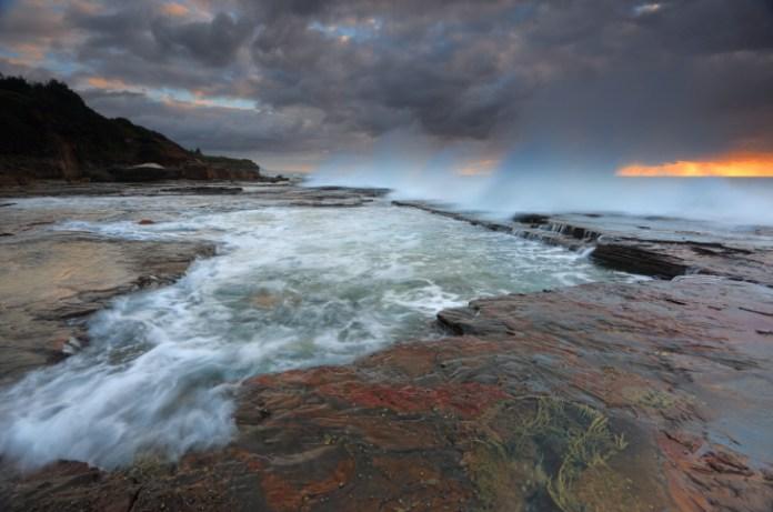 Waves smash against the rocks at Coledale