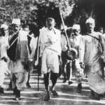 Mahatma Gandhi leads the Salt March. The Delhi government inaugurated ten Mohalla clinics in honour of Gandhi's memory amidst 150th birthday celebrations for the independence leader. Salt March epitomises his commitment to nonviolence.