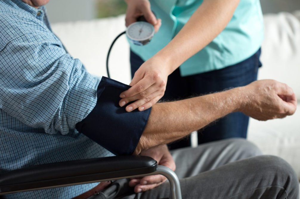 Close-up of assessment elderly patient being measured for high blood pressure