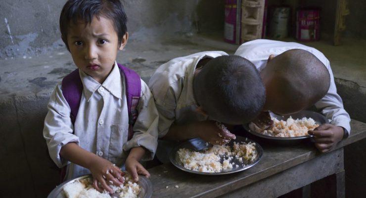 children. School children having mid-day meal in school, Radhu Khandu Village, Sikkim, India. Image credit: Keith Levit / 123rf