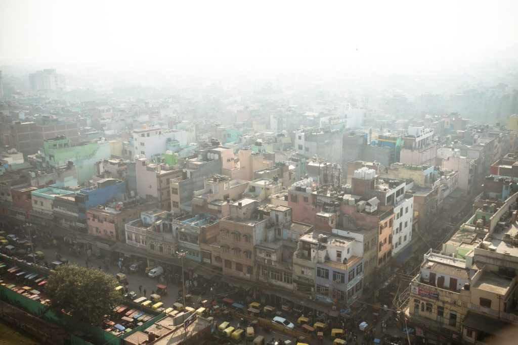 Top view of the city street in the poor quarter of new Delhi. Air pollution and smog in crowded cities. Delhi blanketed by smog. Urban Image credit: Dmitrii Melnikov / 123rf