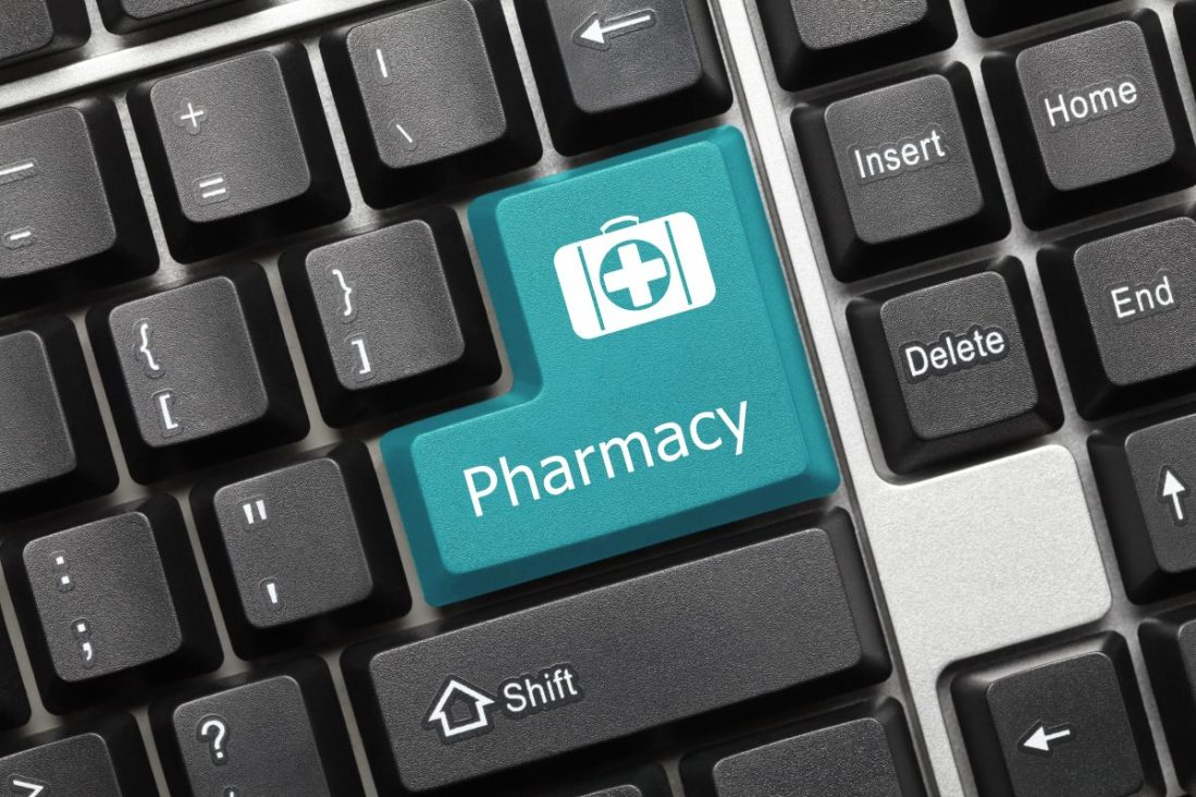 Close-up view on conceptual keyboard - Pharmacy (blue key) E-health concept.