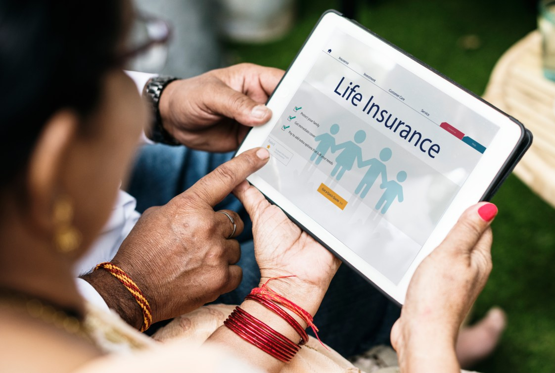 Indian family interested in life insurance. Insurance schemes concept