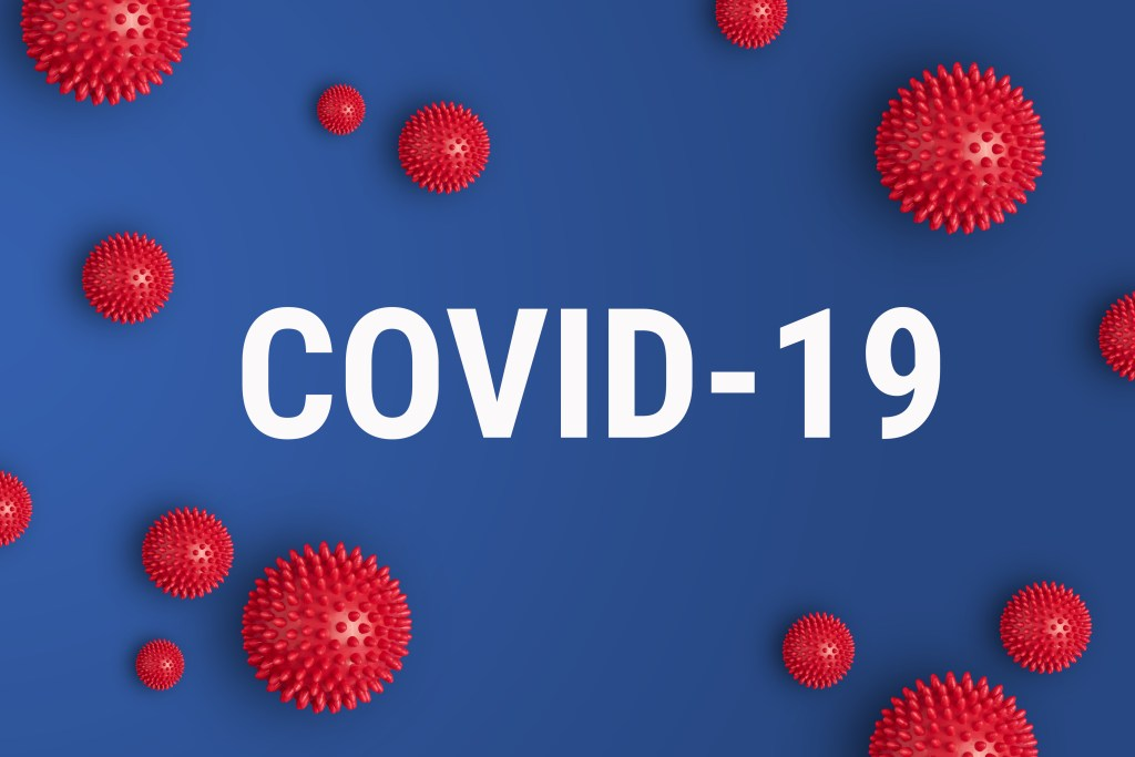 Stock Photo - Inscription COVID-19 on blue background. World Health Organization WHO introduced new official name for Coronavirus disease named COVID-19. COVID-19 outbreak concept. Image credit: nunataki / 123rf