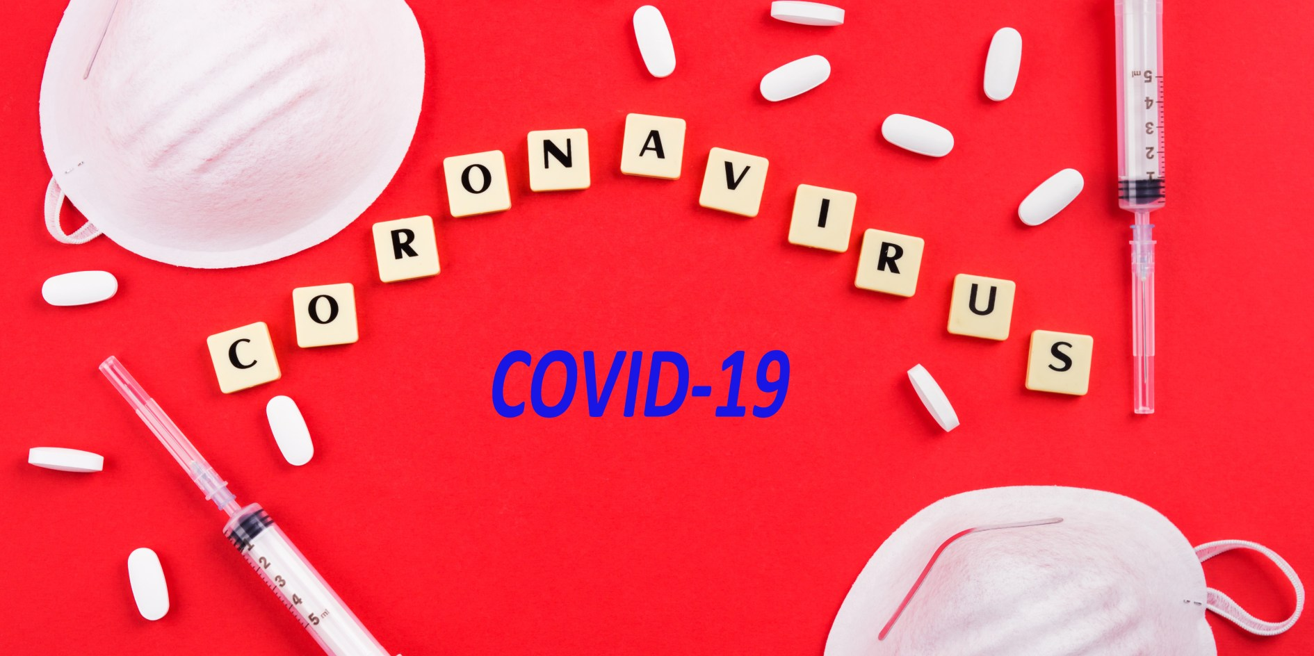 Novel coronavirus 2019 from Wuhan, China, named Covid-19. Epidemic danger prevention. Vaccine, treatment concept with masks, syringes and antibiotic pills and text in letter tiles. COVID-19 deaths concept. COVID-19 in India concept. COVID-19 infections illustration.