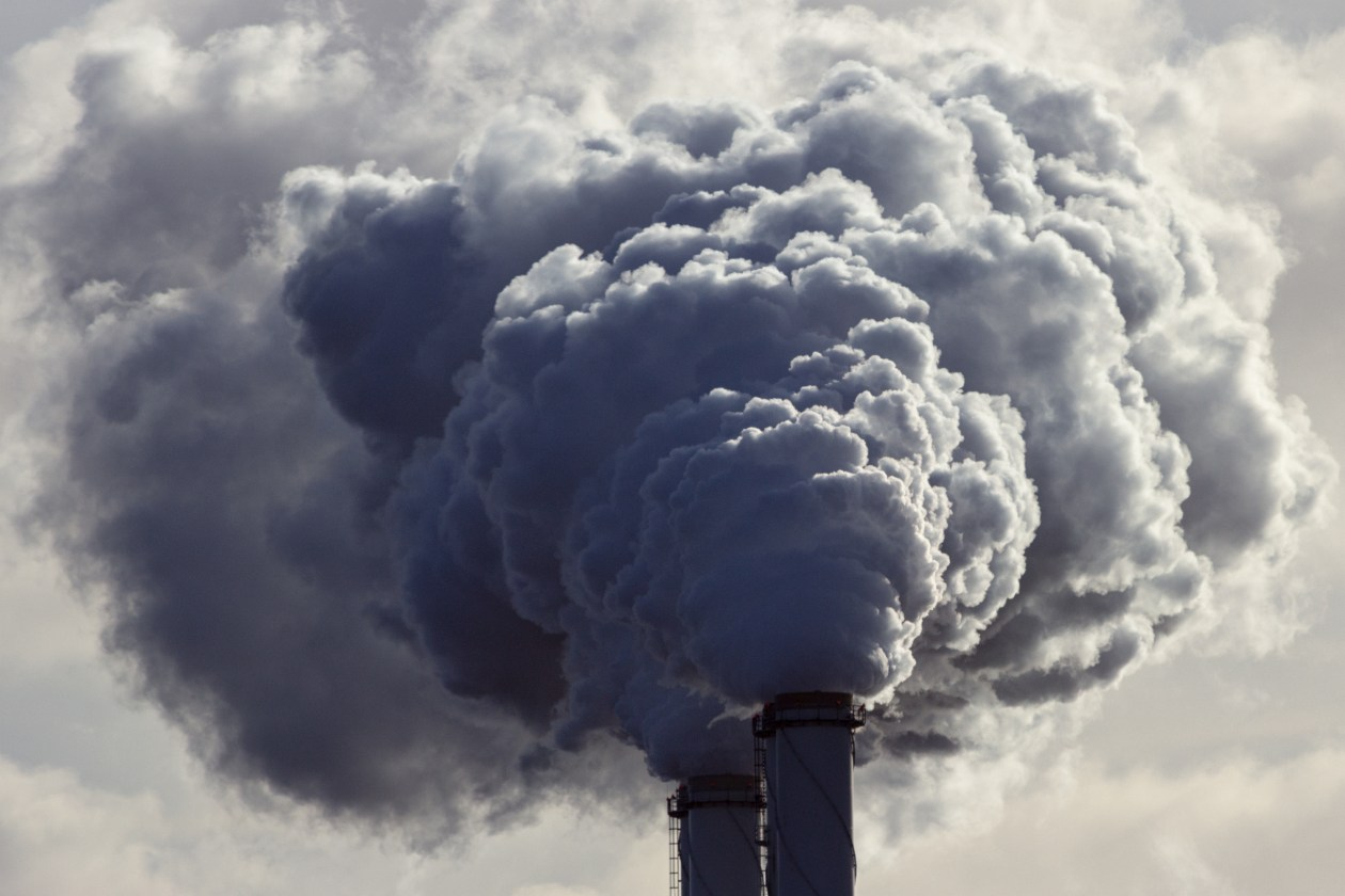 Air pollution from power plant chimneys. Toxic air concept.