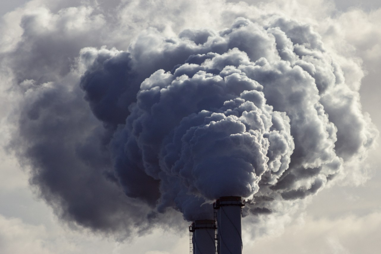 Air pollution from power plant chimneys. Toxic air concept. Mother Earth illustration.