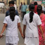 Stock Photo - Indian nurses at road. Street photo, Shot at Gandhi Maidan, Patna, Bihar, India on 25.02.15 at afternoon hours. image credit: UPA GHOSH / 123rf. Nurses pictured in Patna, Bihar in 2015. Image credit: UPA GHOSH / 123rf. Midwives concept illustration.