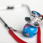 Globe with a stethoscope.. World Health Day illustration. Image credit: olegdudko / 123rf