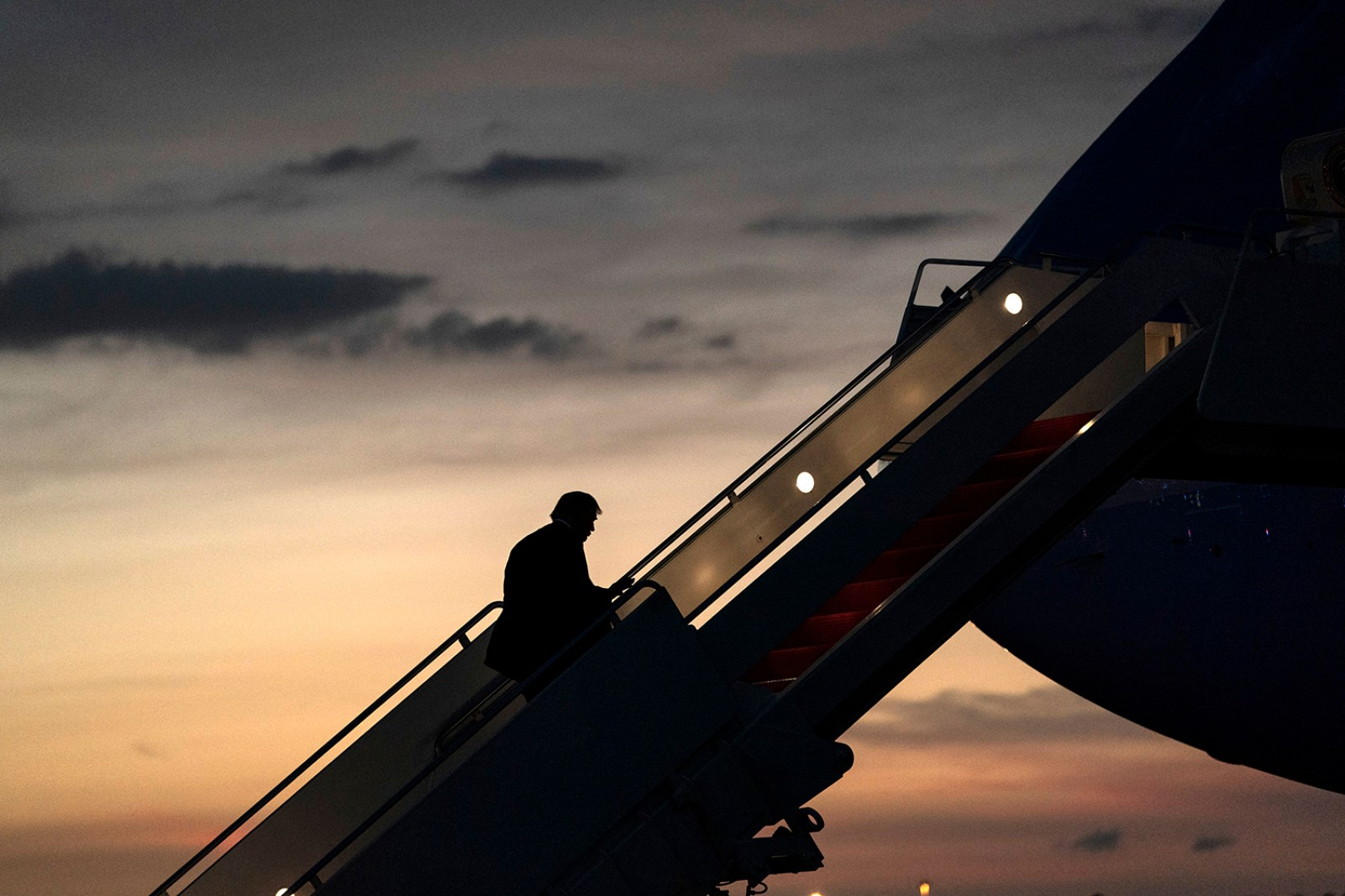 President Trump boards Air Force One for his return flight home from Tampa International Airport in Tampa, Fla. Friday, July 31, 2020, en route to Joint Base Andrews, Md. (Official White House Photo by Joyce N. Boghosian)
