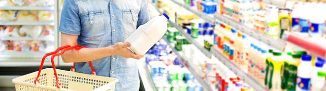 man buying milk
