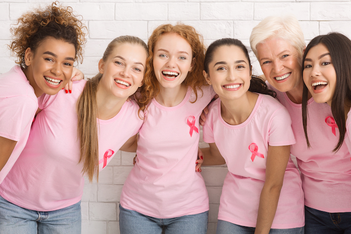 Women With Pink Breast Cancer Ribbons Laughing
