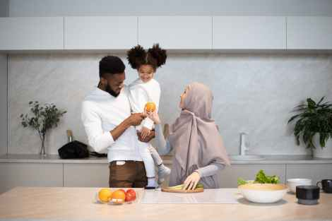 content diverse family together in kitchen