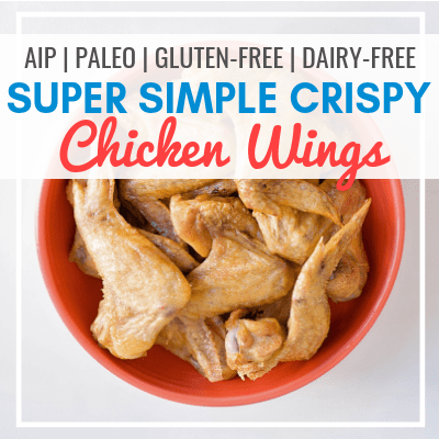 orange bowl of golden-brown chicken wings with text overlay - AIP, Paleo, Gluten-Free, Dairy-Free Simple CRISPY Chicken Wings