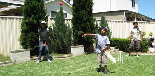 children playing backyeard cricket