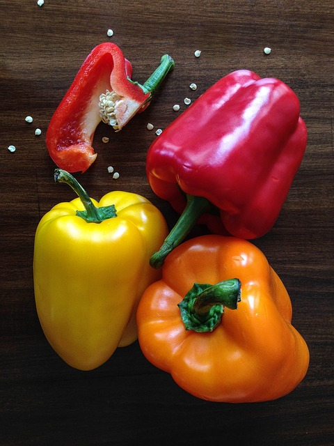 183mg/100g for Yellow Peppers, 192mg/100g fpr Sweet Red Peppers