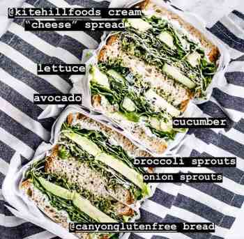 the ultimate veggie sandwich loaded with kite hill cream cheese style spread, sprouts, cucumber, tomato, lettuce, kale pesto, avocado and makes for one delicious gluten-free, vegan lunch