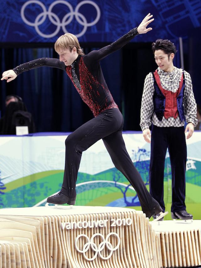 Evgeni Plushenko Vankouver Olympics jumps over podium