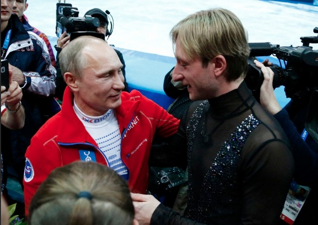 Evgeni Plushenko talks to Vladimir Putin at Sochi Olympics after Team gold medal