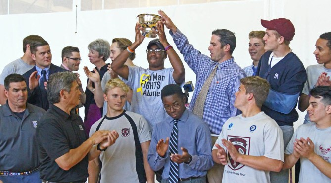 The St. Joseph's Prep rugby team receiving the inaugural Hurtado Cup
