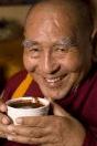 Monk Enjoying Hot Cocoa Drink