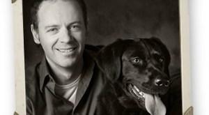 Black Dog with Smiling Man