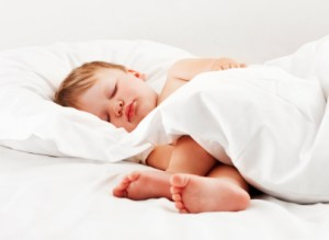 Sleeping Child Lying in Bed
