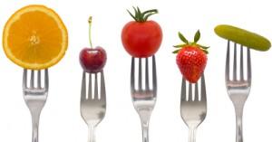 Different Forks Holding Different Fruit