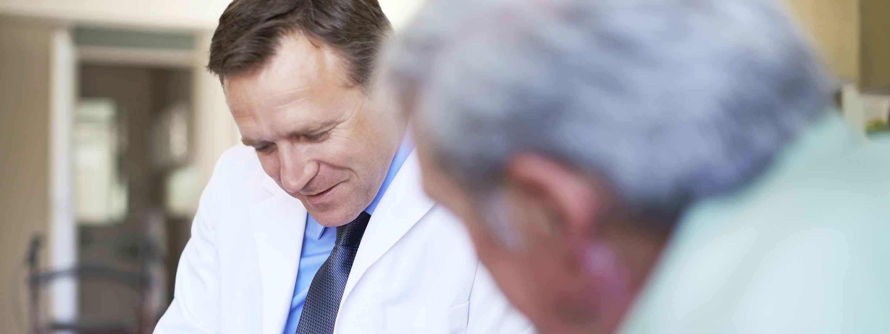 Audiologist talking to a patient about hearing insurance